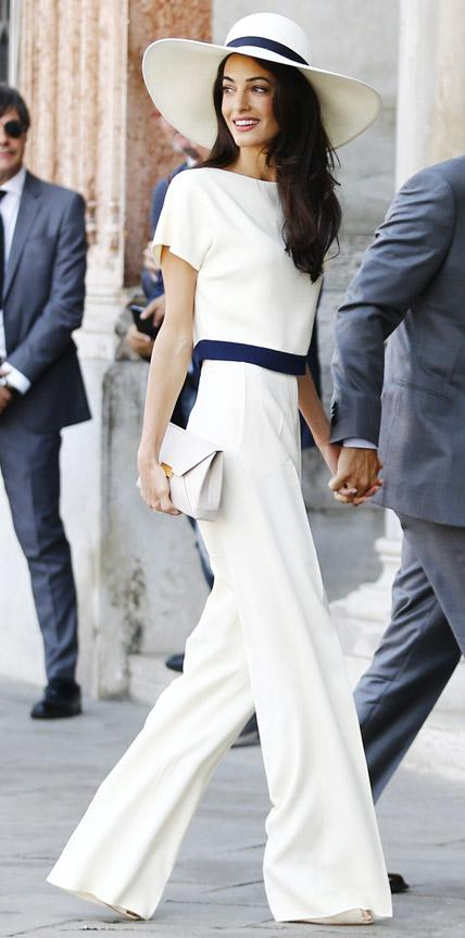 Rocking a strong, tailored pantsuits with a wide white hat. Absolutely elegant!!