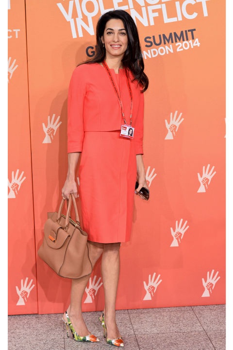 Her work wear Is super professional .One of the key qualities in a fashion icon is being able to dress for any  occasion. Let this be proof that Amal can do it by wearing an orange suit, camel bag and floral pumps to create a great contrast