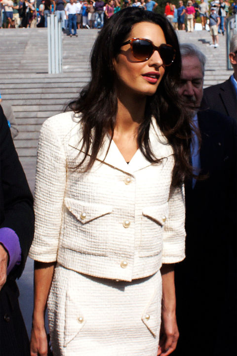 Here she sported a beautiful cream-colored Chanel skirt suit that flattered her petite frame.