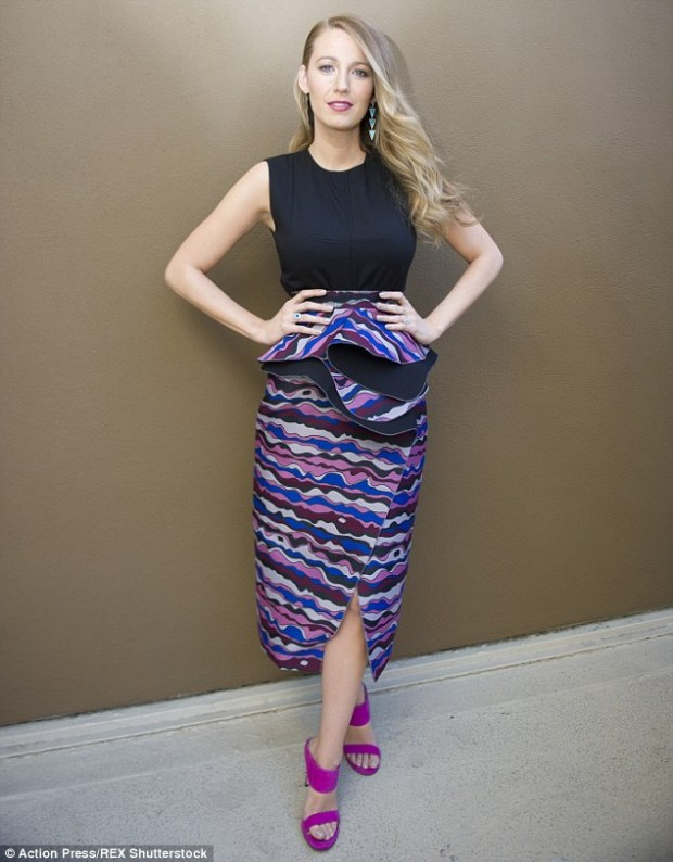 She attended a press conference to promote The Age of Adaline in LA. Loved the skirt with the  purple heels.