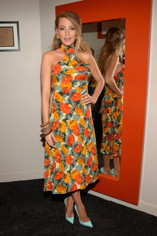 In another promotional appearance hours later, Blake wore a floral printed dress with Christian Louboutin shoes.