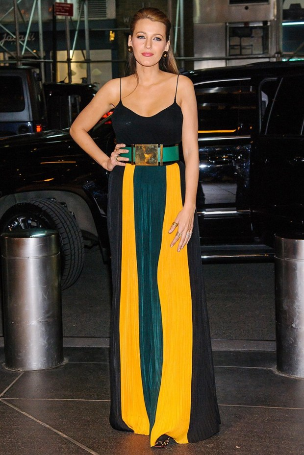 In her eighth outfit of the day, she wore striped yellow, green and black Balmain trousers with a statement belt as she arrived at her hotel in New York.